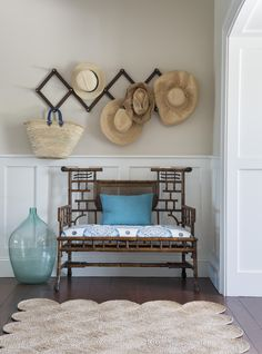 Beach house chic in the foyer with vintage bamboo settee Kate Jackson Design