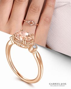 A pretty pink morganite center stone is the undeniable focal point of this feminine fashion ring. The oval cut stone is set horizontally and encircled by ribbons of twisted 14K rose gold. Bezel set round diamonds lend 0.03cts of subtle sparkle to the shoulders of the band.  LR51435K45MO #GabrielNY #DiamondJewelry #FineJewelry #GabrielAndCo #UniqueJewelry #Jewelry #FashionJewelry #GiftIdeas #UniqueGifts #LadiesRing #FashionLadiesRing #RoseGoldRing #RoseGoldFashionRing #GoldFashionRing… Perfect Engagement Ring, Engagement Rings, Diamond Rings, Diamond Jewelry, Morganite Engagement, Three Stone Rings, Cute Jewelry, Unique Rings, Fashion Rings
