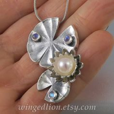 WHITE LOTUS pearl silver pendant with moonstones Ready to ship | Etsy Silver Pearls, 925 Silver, Sterling Silver, Ancient Egyptian Religion, Jewelry Insurance, Lotus Jewelry, White Lotus, Moonstones, Rainbow Moonstone