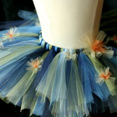 Moody blue & green tulle with warm bursts of gold and copper echo twinkling stars in a swirl of sky. An homage to Van Gogh.