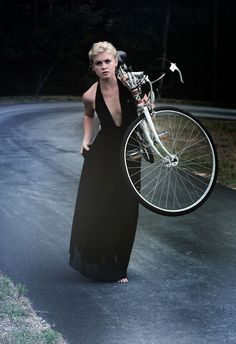 I just LOVE this picture. And imagine what a kick that women must be to mix an evening gown with a bike. Awesome. I want to be that girl.