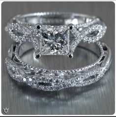 Verragio engagement ring and wedding band.  might be too thick of a band, like the stone to stand out more,  but love the style. more so the wedding band than the engagement ring...