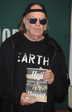 """Neil Young had a busy day in New York, signing copies of his new book, """"Special Deluxe: A Memoir Of Life and Cars"""" at Barnes and Noble on Oct. 14, 2014."""