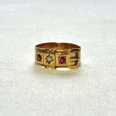 Victorian Ruby & Diamond Buckle Ring   18ct yellow gold 'buckle' ring hallmarked and dated Birmingham 1896, set with a Victorian cut diamond and two rubies, UK size O1/2 - US size 7 1/2.  Weight 4.8 grams   by VintageFineJewellery