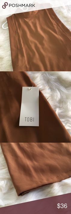 ✨ Tobi Sleeveless Mini Dress BRAND NEW. TAGS IN TACT. Very cute sleeveless mini dress! Listed as Topshop for exposure, brand is Tobi. This dress can be worn up or down for day or night 👌🏼🚫 NO TRADES 🚫 Offers less than 90% of listing price will not be considered! Please make a reasonable offer 😄❤️ Topshop Dresses Mini