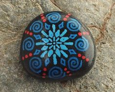 Hand-Painted-Alchemy-Beach-Stone-with-Blue-Red-Snowflake-Spiral-Design