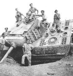 Polish 3rd Carpathian Division men posing next to a Panther of 1./Pz.Rgt.26 on 17 May 1945.Interesting use of extra plat e on the turret and tracks
