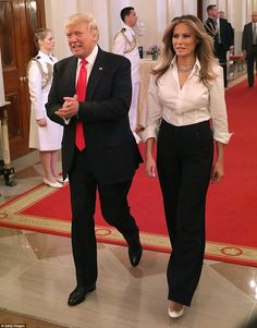 Melania, 47, looked stunning in a pair of wide-leg black pants and a casual white button-down to attend an event honoring military mothers on Friday, while Ivanka, 35, stepped out in pink.