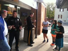 Officer Hanrahan and Officer Trampe meeting with residents.