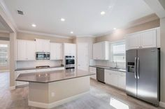 This kitchen is EMPTY! If you could pick the decor, what would it BE?!