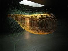 Sean McGinnis - Working freelance at the dynamic and creative Casey Vidalenc Fashion House in Paris, he discovered string as a creative material, first sewing on clothes, then sewing on his own drawn and photographic work.  The strings ended-up flying off the support and began filling rooms.  And there, miles and miles of string and hours of labor later, they form spheres, cones, intersecting wing shapes, or gothic arches, layers upon layers like 3-dimensional architectural drawings