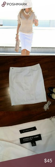 White pencil skirt Ready for summer  White from the high end Collection line of Jones New York  Size 16 23 inches long NEW WITHOUT TAGS zipper back and kick pleat Fully lined and not see through 99% cotton  1% elastin Decroctive gold tone button details on waist 20 inches across waist lying flat Jones New York Skirts Pencil