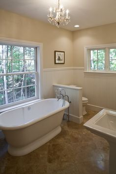 Collamore Built | Residential Design and Construction: Chandelier in Bathroom, Free Standing Traditional Tub, Beadboard Wainscotting, Pedestal Sinks.