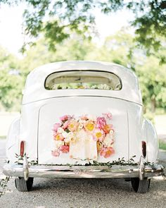 """A """"Just Married"""" sign and pink and white flowers were affixed to this bride and groom's getaway car. Wedding Exits, Wedding Signs, Wedding Photos, Wedding Cars, Coral Wedding Decorations, Wedding Getaway Car, Just Married Sign, Pink And White Flowers, Fresh Flowers"""