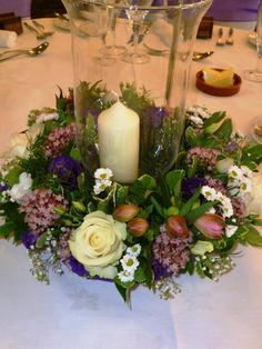 Lilac theme #wedding flowers, with church candle in Hurricane vase