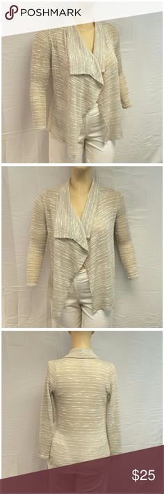 40% BUNDLE DISCOUNT! FREE SHIPPING ON BUNDLES!! RHAPSODIELLE Flyaway Cardigan, size See Measurements Pictured on a Plus 16 to 20 size mannequin but tag says Small  (LOL, measurements will be posted After the football playoff games), silver n gold metallic throughout, stretchy sheer lightweight material, 57% polyester,  31% rayon, 7% nylon, 5% spandex, approximate measurements:  tag = small???  ADD TO A BUNDLE!   40% BUNDLE DISCOUNT! FREE SHIPPING ON BUNDLES!! ?OFFER? 40% less Plus $6 LESS ON…