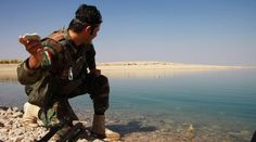 This photo shows an Iraqi Kurdish soldier skipping a rock in one of the Dams in the Tigris River.