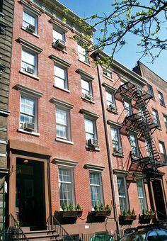 Both townhouses have historic brick exteriors.