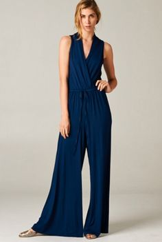 TUA 'Jump On Board' Jumpsuit - 'Jump on board' any yacht in this sleek wide leg pantsuit and you'll fit in with no problems! In classic navy, this jumpsuit features a cross over wrap front and elastic waist with a drawstring tie. This sleeveless piece goes from day to night very easily and should be a wardrobe staple in your closet. Available in navy. Sleeveless. Wide leg. By Tua.