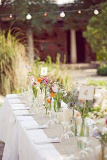 banquet tables. white cloth, tan runner.