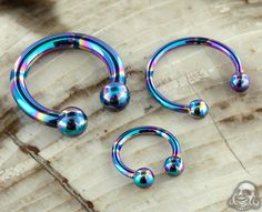 Internally threaded oilslick circular barbell