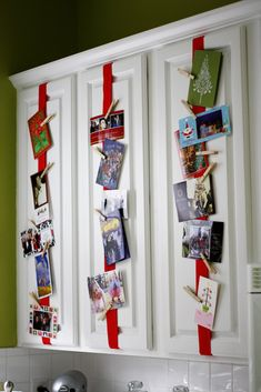 Attach ribbon to kitchen cabinets. Use clothespins to hang Christmas cards.  CUTE.