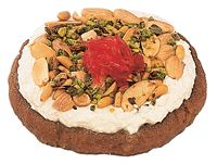 Mafroukeh recipe - toasted semolina base (with butter), topped with cream, toasted nuts, syrup and sugared rose petals for garnish!