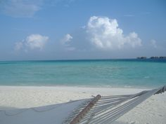 Place to relax on the beach at the Conrad Maldives in the Indian Ocean