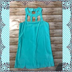 "Boutique Fabulous Mint Dress. From my Boutique Shop.  This dress is mint and the cut outs at top make this a beautiful unique dress.  It zips at the back. Dress it up or down.  This dress is also a great vacation dress.  The length is 33"", made of polyester. Boutique Dresses Midi"