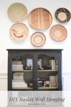 Have tons of flat basket or want to learn where to find them cheap and how to hang them. See the blog. #basket #basketideas #walldecor Cheap Home Decor, Diy Home Decor, Hanging Swing Chair, Diy Planter Box, Diy Fall Wreath, White Wicker, Diy Mirror, Basket Decoration, Baskets On Wall