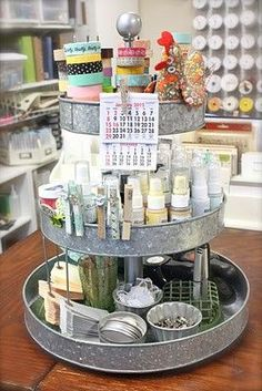 Mud Pie Studio: 101 Ways to Decorate Tiered Plate Stands - great way to organize my cake stuff and keep accessible.