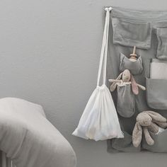 noº74 silver grey Wall Pocket | White Swaddle bag | Source: @virginemamapapa on Instagram