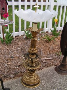 Birdbath made using an old lamp and a vintage ceiling mount glass cover. Awesome garden idea!  [http://chiccottagejunk.blogspot.com/]