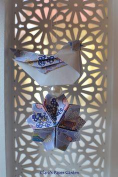 origami bird and sakura flower