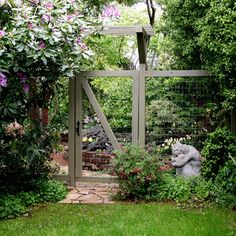 """""""Painted fence with wide chicken wire. It's practically see-through but still provides all the benefits of a fence. This is a great solution for dogs if you want and need a taller fence, but don't want to block the view."""""""