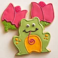 Delightful frog sugar cookies decorated with royal icing.