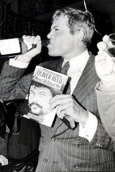 Oliver Reed at the launch of his book, 'Reed All About Me', with his staple drink in hand, Photograph by Bill Cross/Daily Mail/REX/Shutterstock. Real Men Quotes, Strong Women Quotes, Woman Quotes, People Quotes, Oliver Reed, Classic Hollywood, Old Hollywood, My Autobiography, Best Bond