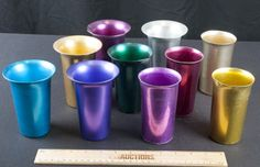 VINTAGE LOT OF ALUMINUM GLASSES MULTI COLORED BY SUNBURST AND THE OTHER 6 ARE PLAIN.