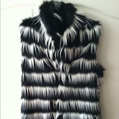 Imposter Limited Edition  Sleeveless Jacket This gorgeous black and white jacket/vest is super soft, fully polyester lined, a medium weight, has secure clasp closures down the front, and is 32 inches long.  It is certified animal friendly and has the tag and silver gem brooch attached to verify this.  It's a faux fur. . 100% Acrylic!! Imposter Jackets & Coats