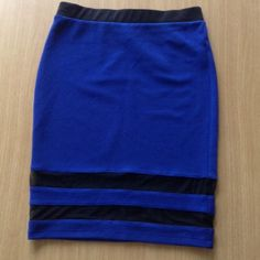 Forever 21 Blue bandage skirt. Has 2 sheer black bands around bottom. Pretty royal blue color. Black waistband and pleated backside. Measures 21 1/2 in. Forever 21 Skirts