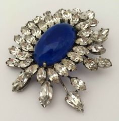 "«BersoАнтик» - Roger Jean Pierre brooch with a central blue stone. Glass, crystal 1960 (...the central blue stone, the mass of small brilliants, and the same five dangling ""tremblers."")"