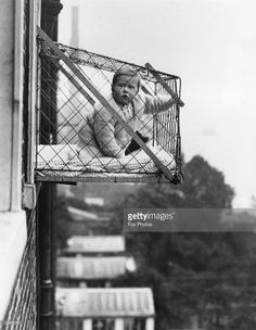 An example of the wire cage which East Poplar borough council in London propose to fix to the outside of their tenement windows, so that babies can benefit from fresh air and sunshine.