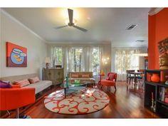 Loving all of the orange decor in this living room  http://www.realtyaustin.com/idx/condos/texas/austin/78727/4400-switch-willo-7/9012215.html