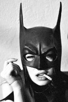 Girl in a batman mask smoking a cigarette. I'm not sure what to think of this...