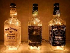 Jack Daniels bottles with white lights - A perfect man-cave addition. Jack Daniels bottles with white lights - A perfect man-cave addition. Festa Jack Daniels, Jack Daniels Bottle, Jack Daniels Wedding, Jack Daniels Party, Alcohol Bottles, Wine Bottles, Liquor Bottle Lights, Bottle Lamps, Glass Bottles