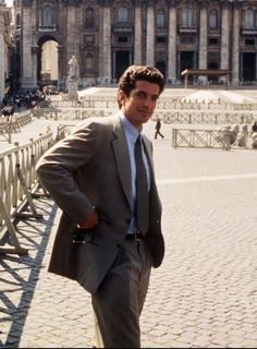 John F. Kennedy Jr. poses in front of St. Peter's at the Vatican Saturday April 20, 1996. Kennedy Jr. is in Italy to interview famed fashion designers such as Valentino, Versace and others.