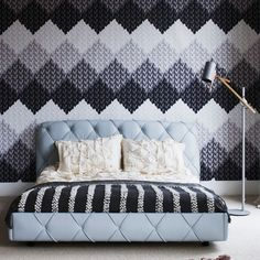 Grey bedroom with modern knitting-design wallpaper