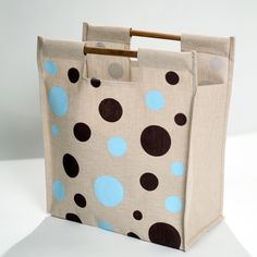 Light blue and chocolate brown polka dots on the front and back add a playful touch to this tote that's made from a durable jute and cotton blend. With eco-friendly bamboo handles and a carrying capac Fabric Crafts, Sewing Crafts, Diy Crafts, Tote Bags For College, Jute Tote Bags, Cardboard Design, Small Sewing Projects, Fabric Bags, Gift Bags