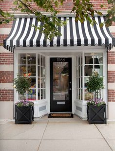 Adorable shop front - very French looking! Cute ...this could work for a front porch too!