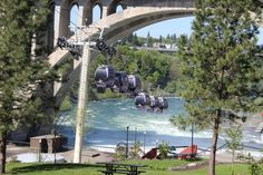 The Everett Herald. June 7, 2014. By Linda Jenkins. Gondolas of the SkyRide move above Riverfront Park and the Spokane River, which was the centerpiece of Expo '74.